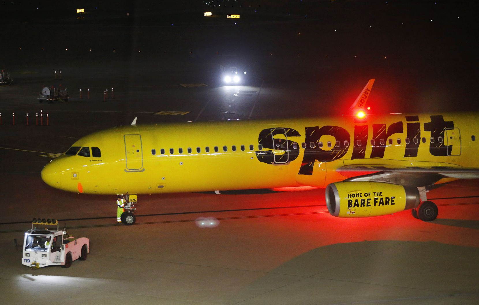 Ground crew workers ready a Spirit Airlines jet for takeoff at DFW International Airport, Wednesday evening, May 8, 2019.