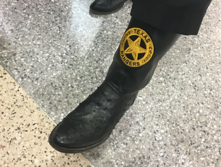 Special prosecutor Brian Wice lifted his pant leg to show the custom Texas Rangers boots he wore to the pretrial hearing of Texas Attorney General Ken Paxton on February 16, 2017. (Lauren McGaughy/Staff)
