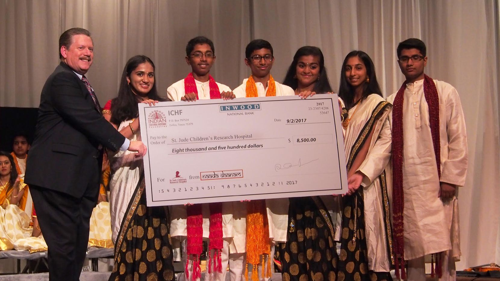 Mesquite Mayor Stan Pickett, with six students who raised funds for St. Jude Children's Research Hospital by presenting an Indian classical music event at the Mesquite Arts Center.