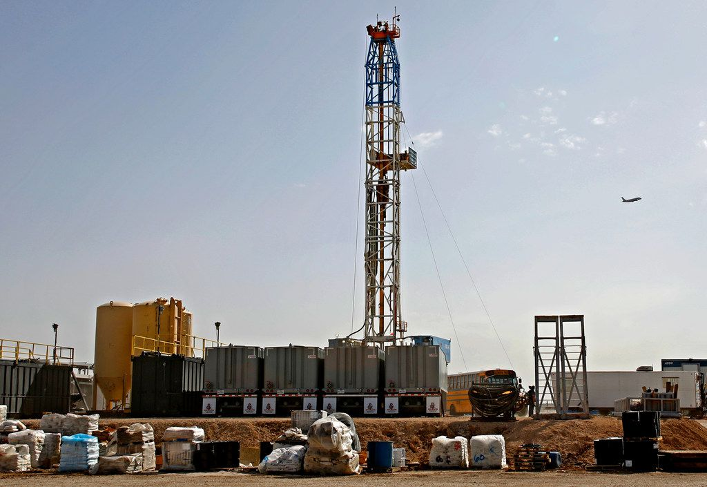 In this April 17 photo, a Latshaw Drilling Rig operates on a Diamondback oil and gas location in Midland County.