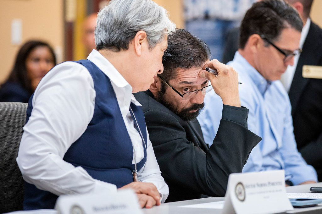 Bishop Daniel Flores confers with Sister Norma Pimentel during a roundtable discussion at the Weslaco Border Patrol Station on Friday, June 22, 2018, in Weslaco, Texas. Senators John Cornyn and Ted Cruz held the roundtable with representatives of federal agencies, non-profits and local elected officials involved in handling immigrant families.