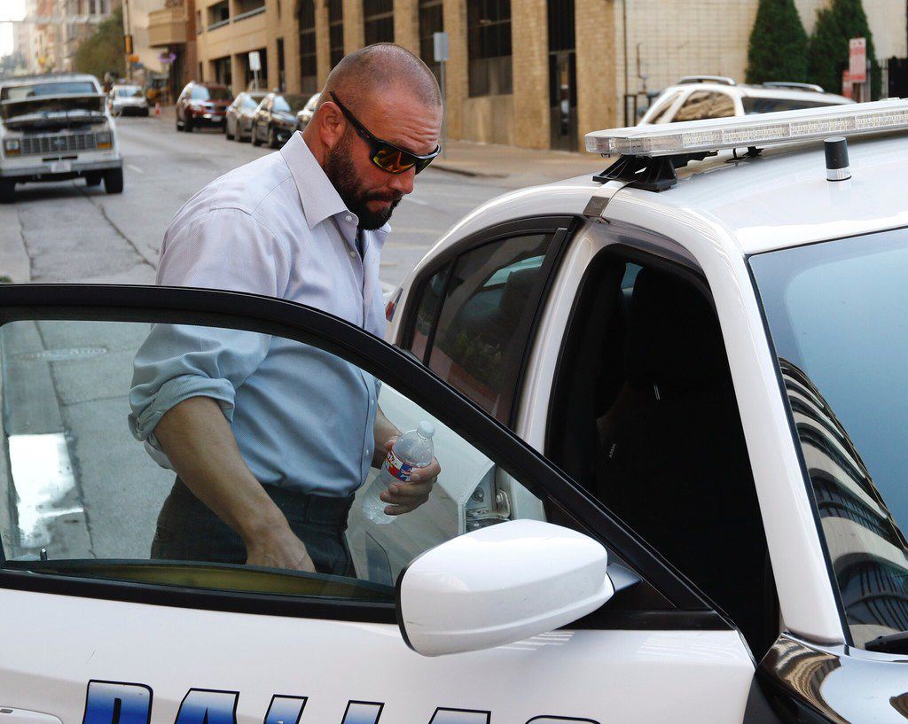 Brian Rowden no longer works for Dallas police but left the courthouse in a squad car.