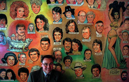 The caricatures on the wall at the Palm Restaurant, pictured here in 1998, quickly became its signature.