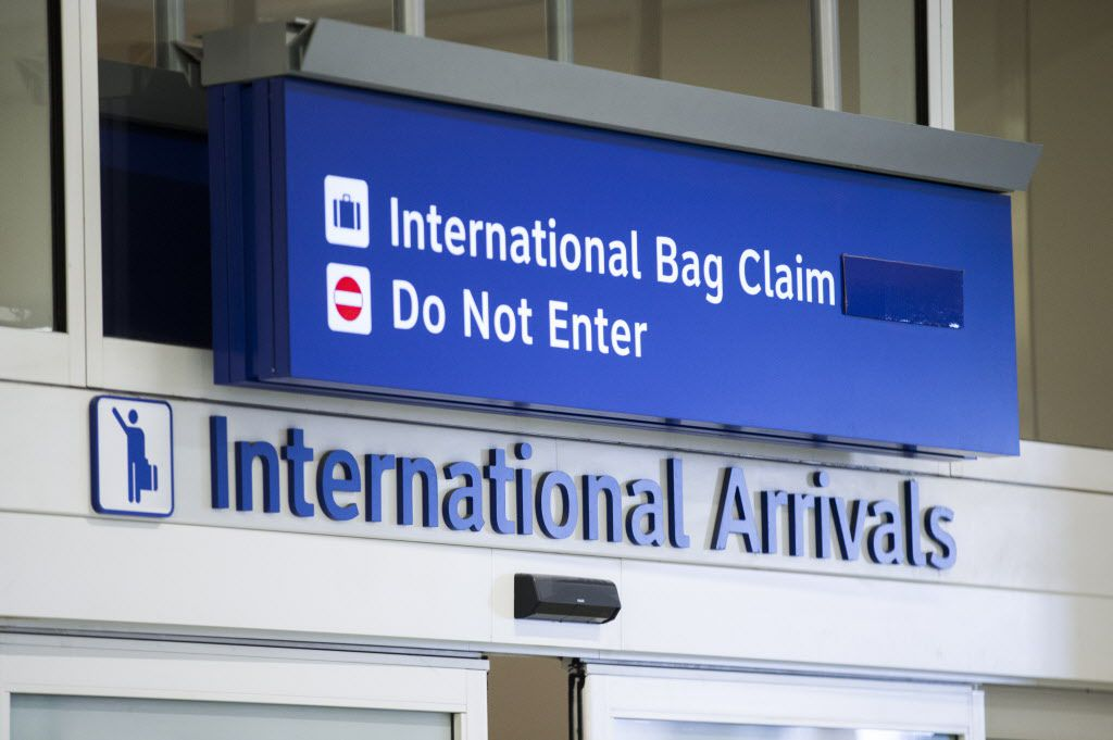 A sign for the international arrivals terminal at DFW International Airport on Wednesday, February 8, 2017 in Dallas.
