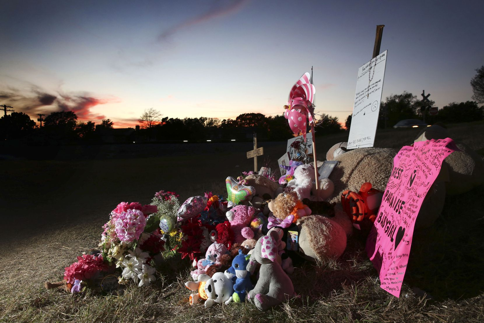 The growing memorial shown on Friday, Nov. 17, 2017, where the body of Sherin Mathews, 3, was found in a culvert near 703 S. Bowser Rd. in Richardson, Texas weeks after she went missing on Oct. 7, 2017.