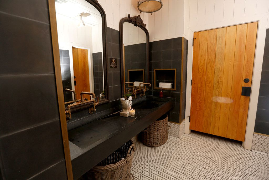 The women's bathroom at Sixty Vines in Dallas on Friday, March 22, 2019. Sixty Vines is the place to go to feel at home. Eat family-style at the long dining tables and be sure to take a visit to the restroom, with a women's stall as big as your own bathroom at home and decorative furniture for some design inspiration. (Rose Baca/Staff Photographer)