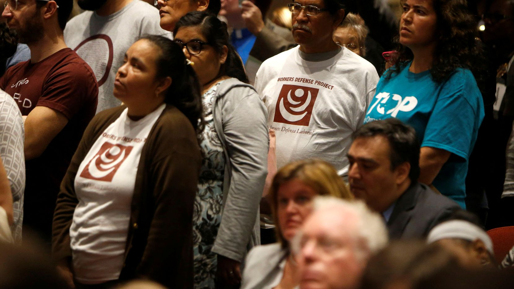 """More than a dozen Dallas-Fort Worth advocacy groups gathered to support the """"Welcoming Communities"""" resolution at the Dallas County Commissioners Court meeting Tuesday. (Rose Baca/Staff Photographer)"""