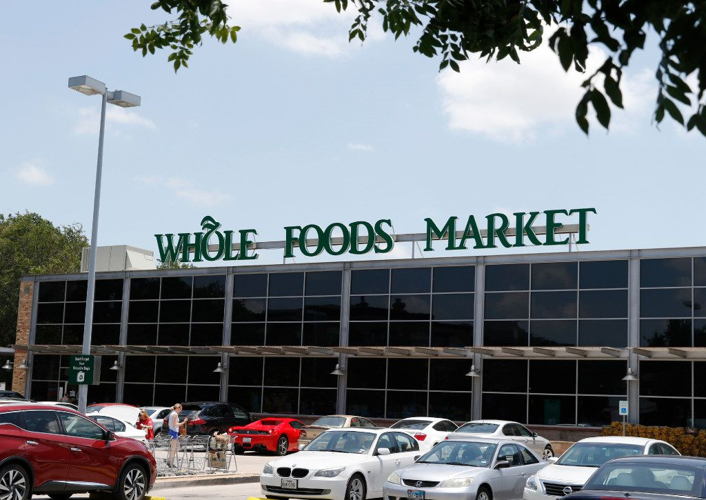 Amazon.com announced Friday saying it will buy Austin-based Whole Foods Market in a deal valued at $13.7 billion. A customer loads her car with groceries, left, in the parking lot at 4100 Lomo Alto Dr. in Highland Park on Friday, June 16, 2017.