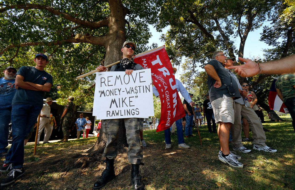 A man who identified himself as Frank from Dallas showed his disrespect for Dallas mayor Mike Rawlings as he paraded with a Donald Trump flag during This Is Texas Freedom Force protest over removal of the Robert E. Lee statue from Lee Park in Dallas, Saturday, September 16, 2017.  (Tom Fox/The Dallas Morning News)