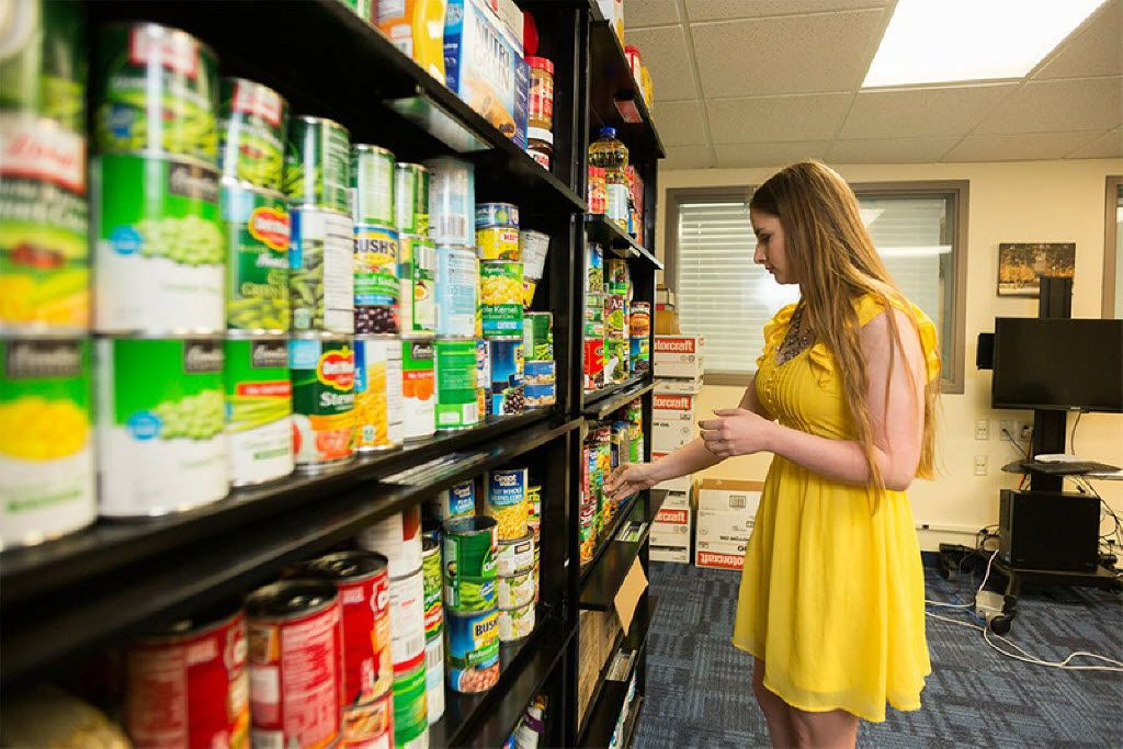 Ashlee Taylor, president of the graduate student advisory council and a Ph.D. student in nutritional sciences at Texas Tech University, organizes the Wreck Hunger graduate and international student food pantry on April 18 in Lubbock.