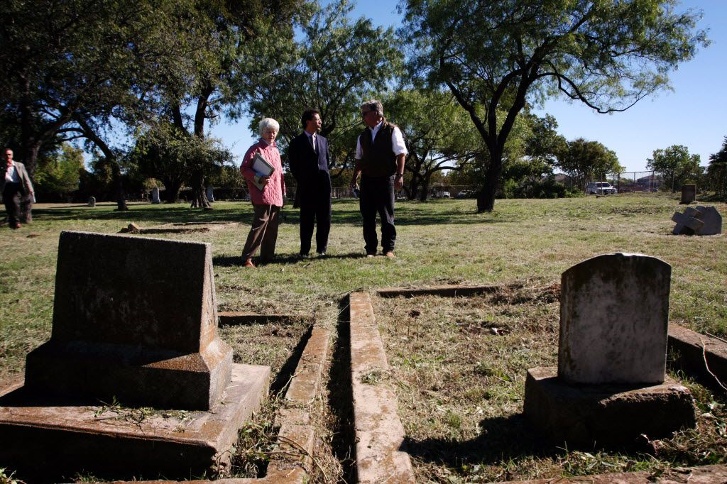 Consul General of France Pierre Grandjouan, center, tours  La Reunion Cemetery with historical researcher Frances James, left, and Christopher Thevenet, a descendant of La Reunion colonists, on Nov. 4, 2010.