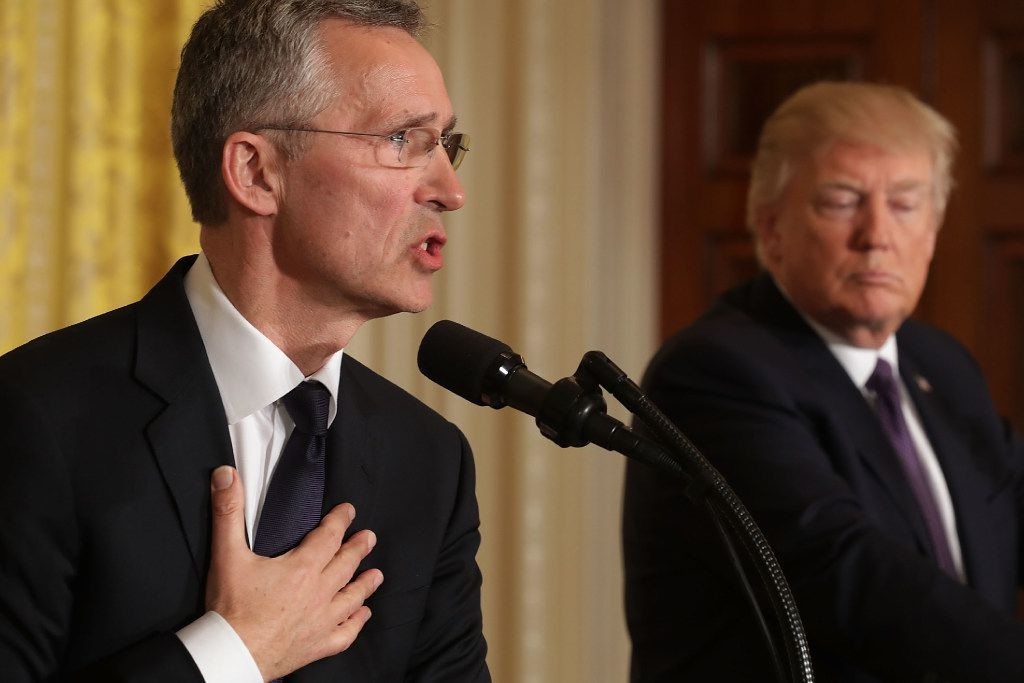 """WASHINGTON, DC - APRIL 12:  NATO Secretary General Jens Stoltenberg (L) and U.S. President Donald Trump hold a news conference in the East Room of the White House April 12, 2017 in Washington, DC. Trump reaffirmed the United States' commitment to the North Atlantic alliance and its """"ironclad"""" pledge to defend NATO allies, even though he repeatedly questioned the relevance of the military organization during the campaign.  (Photo by Chip Somodevilla/Getty Images)"""