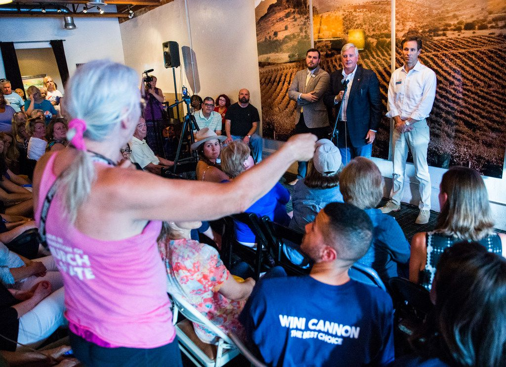 From left, Democratic candidate for Texas Senate District 2 Kendall Scudder, Democratic candidate for Lieutenant Governor Mike Collier and Democratic candidate for Texas Senate District 6 Nathan Johnson answered questions from the crowd during a town hall meeting hosted by the Funky East Dallas Democrats at 2018 Kidwell Street on July 2.