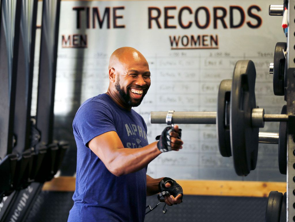 Donovan Lewis, The Ticket radio co-host from 10 a.m. till noon, laughs between grimmaces as he ups the weight on his bench press workout at The Alpha Project gym.