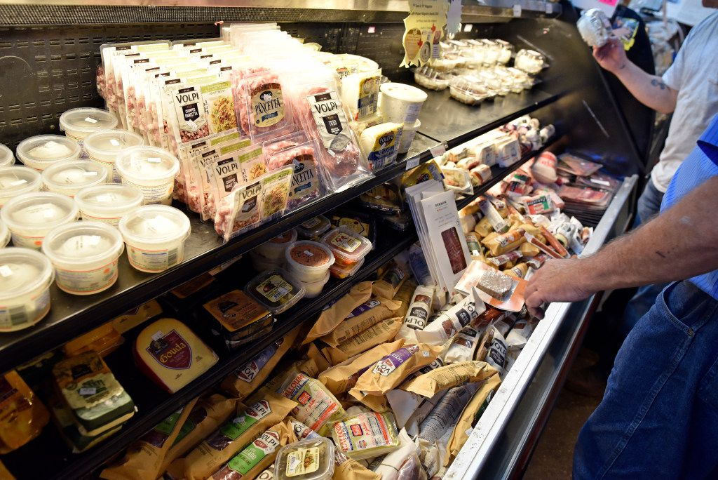 Shoppers browse through the charcuterie case at Jimmy's Food Store in Dallas, Friday, April 7, 2017. Ben Torres/Special Contributor
