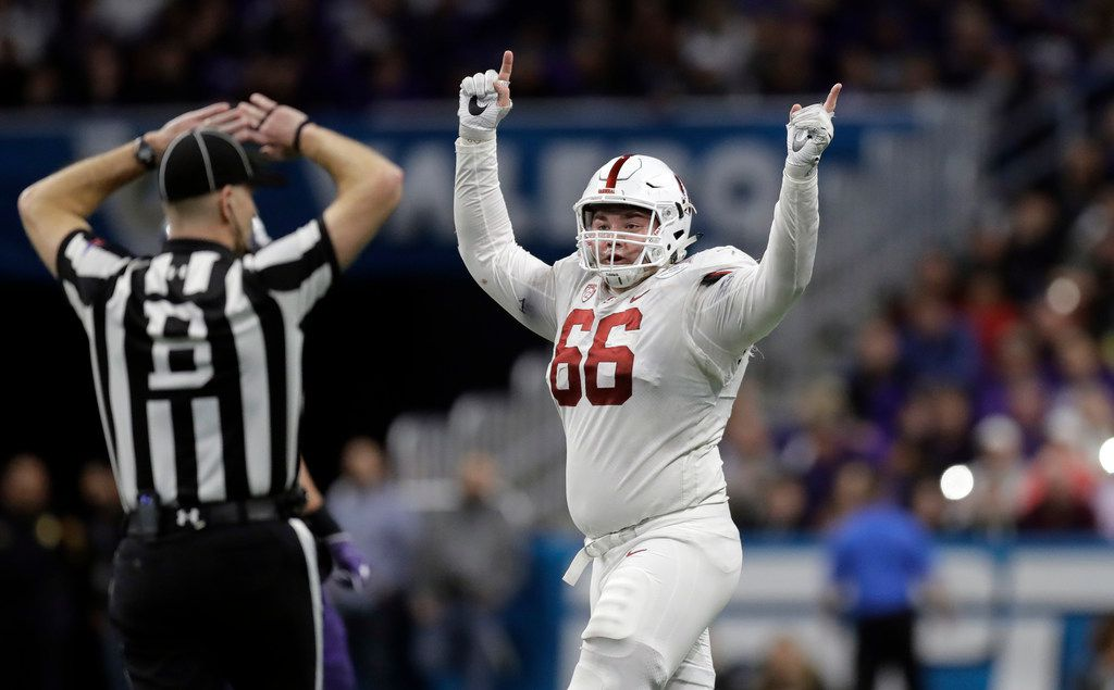 FILE - Stanford defensive tackle Harrison Phillips (66) celebrates after the Cardinal recovered a TCU fumble in the second half of the Alamo Bowl on Thursday, Dec. 28, 2017, in San Antonio. (AP Photo/Eric Gay)