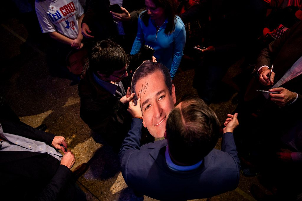Senator Ted Cruz signs a cutout of his head following a campaign rally at Cendera Center in Fort Worth on Friday, November 2, 2018. (Shaban Athuman/The Dallas Morning News)