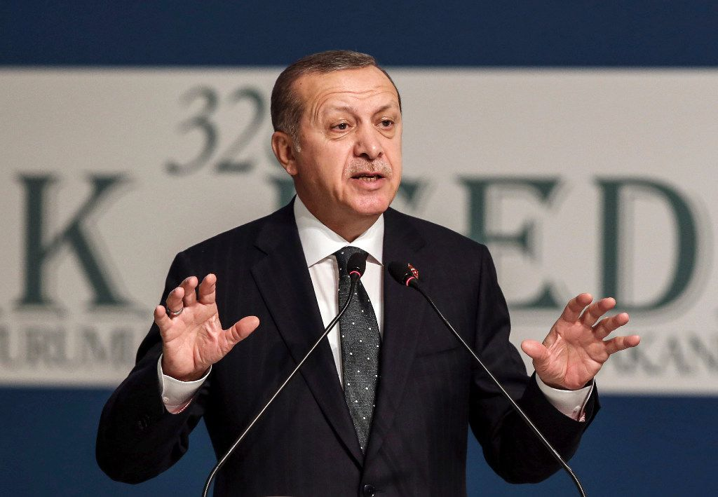 Turkish President Recep Tayyip Erdogan responded to Donald Trump's proposed Muslim ban by threatening to remove the Trump brand from all Trump properties in Turkey. (Yasin Bulbul/The Associated Press)