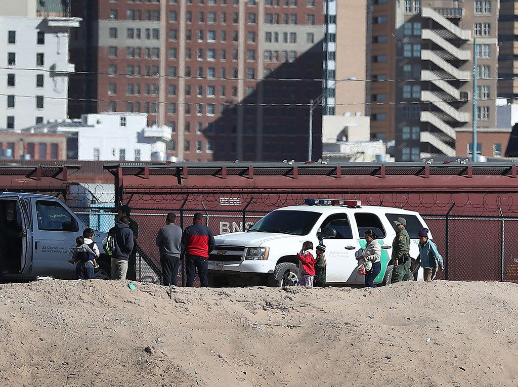 A group of people turn themselves over to U.S. Border Patrol agents as they ask for asylum consideration on Jan. 13, 2019 in El Paso.