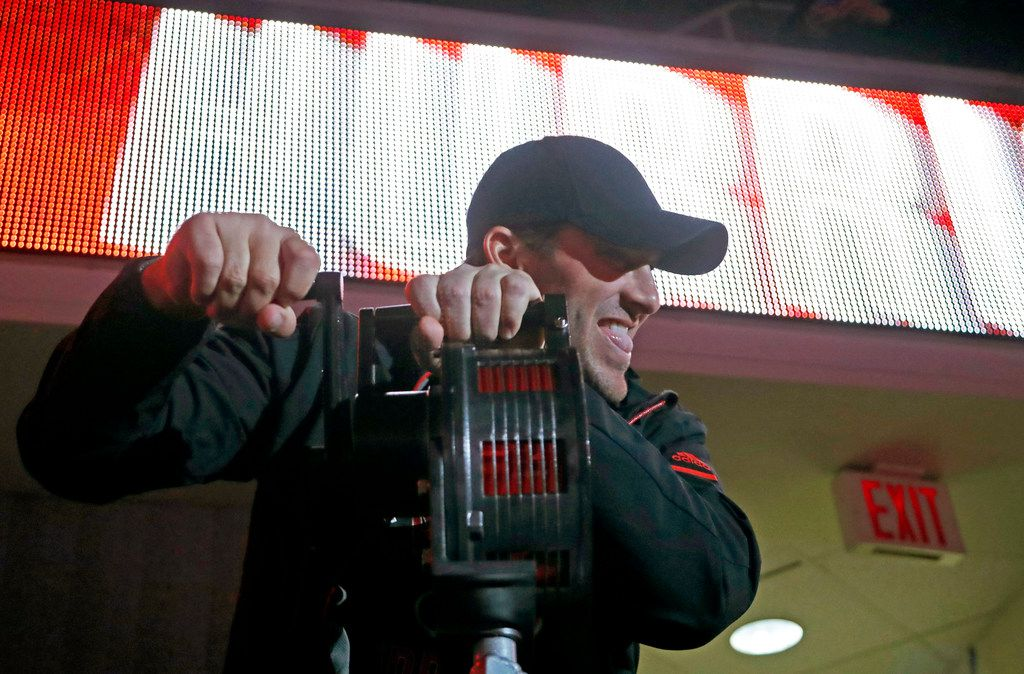 Former Dallas Cowboys quarterback Tony Romo sounds the siren before the Carolina Hurricanes play host to the New Jersey Devils at PNC Arena in Raleigh, N.C., on Friday, March 2, 2018. The Canes won, 3-1. (Chris Seward/Raleigh News & Observer/TNS)