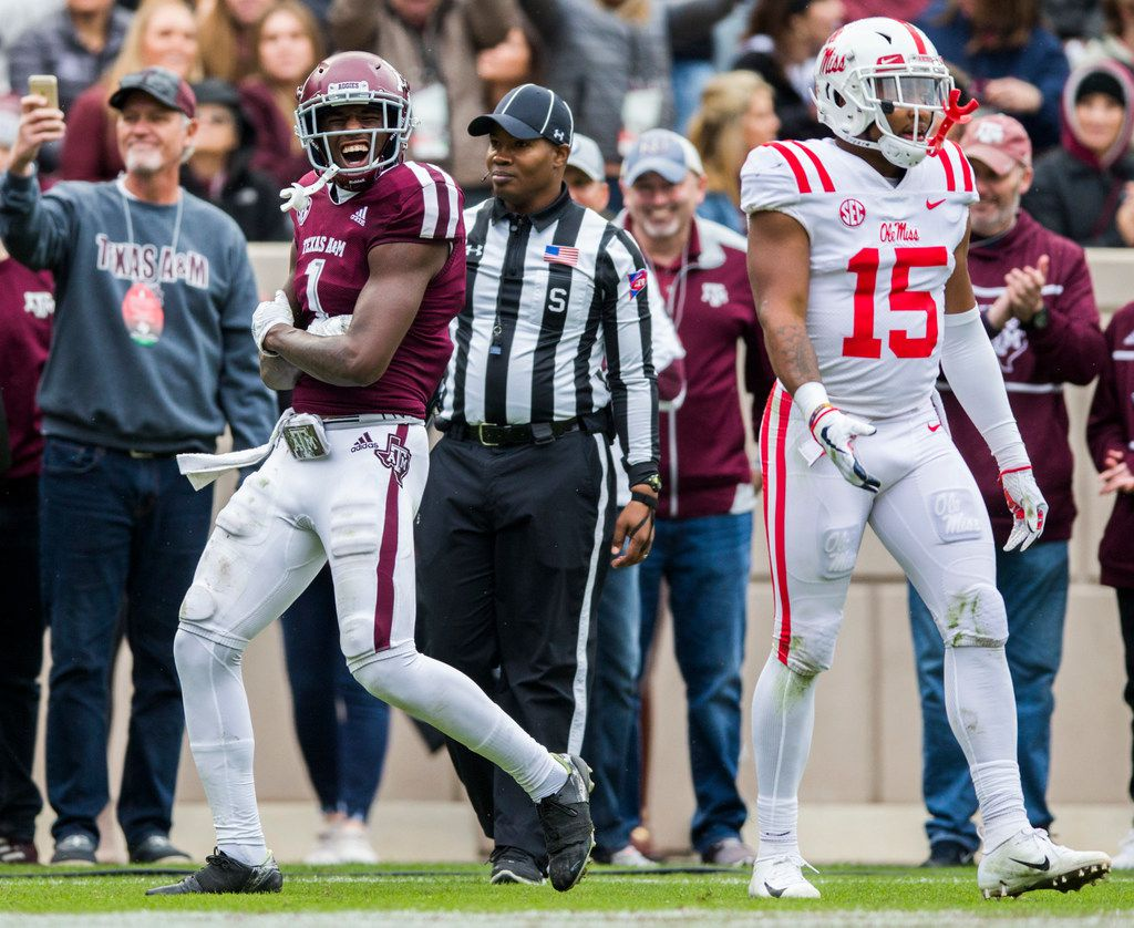 Texas A&M Aggies wide receiver Quartney Davis (1) celebrates after wide receiver Camron Buckley (14) scored a touchdown during the second quarter of a college football game between Texas A&M and Ole Miss on Saturday, November 9, 2018 at Kyle Field in College Station, Texas. Ole Miss Landsharks defensive back Myles Hartsfield (15) is at right. (Ashley Landis/The Dallas Morning News)