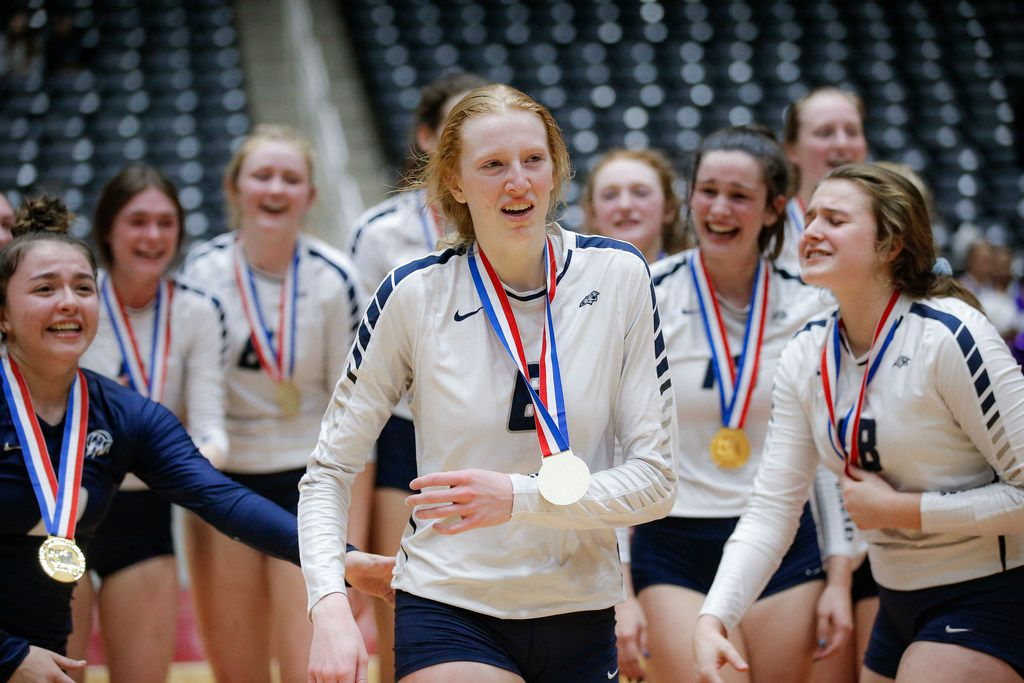 Flower Mound sophomore Kaylee Cox (6) is congratulated by teammates after being named MVP in the Class 6A State Championship volleyball game against Ridge Point at the Curtis Culwell Center in Garland, Texas, Saturday, November 17, 2018. (Brandon Wade/Special Contributor)
