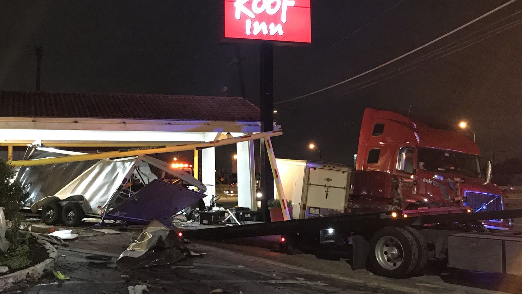 The exterior near the lobby of the Red Roof Inn in Plano was scattered with debris after a wrong-way driver crashed into the awning Tuesday morning.