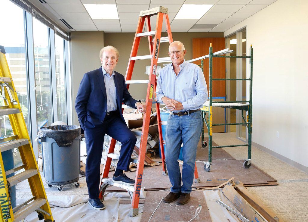 Former Dallas Cowboys players and now real estate partners Roger Staubach (left) and Robert Shaw are pictured in Roger's new office under construction at Columbus Realty Partners in Dallas.