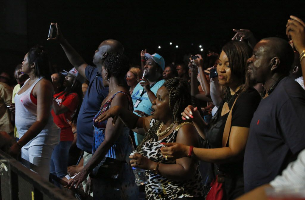 The audience dances as LL Cool J performs during the Kings Of The Mic concert at Gexa Energy Pavilion in Dallas Friday, June 26, 2015.