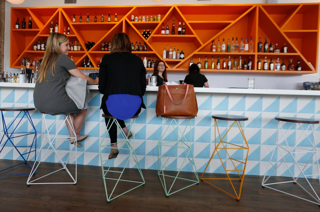 Taylor Gainan, left, and  Elise Lynott, conduct business at the Halcyon Coffee Bar and Lounge on Tuesday afternoon  March 28, 2017. The new coffee bar and lounge is located at 2900 Greenville Ave. in Dallas.
