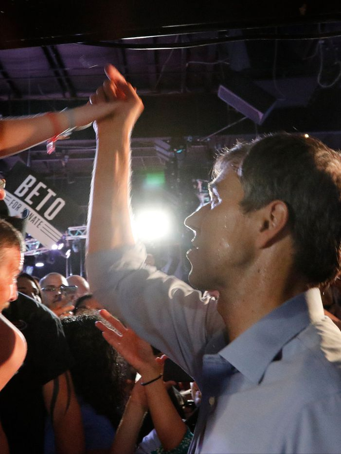 Beto O'Rourke hi-fives a fan after a rally at the Houston Stampede Event Center in Houston Texas, on Saturday, September 8, 2018. Ted Cruz campaigned in Humble, Texas, Texas on Saturday, while Beto O'Rourke campaigned a few miles away in Houston, Texas.