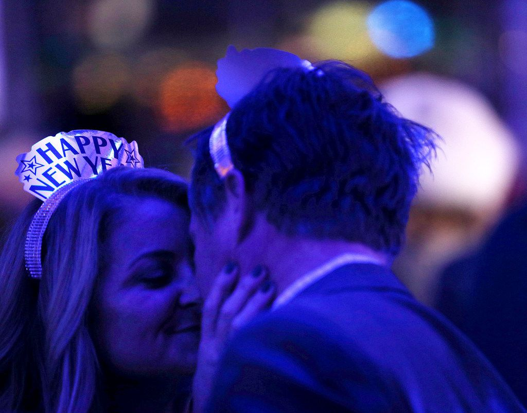 Kim Townsend kisses Chris Queen, both from Plano, during a New Year's Eve party at Saint Rocco's New York Italian at Trinity Groves in Dallas.