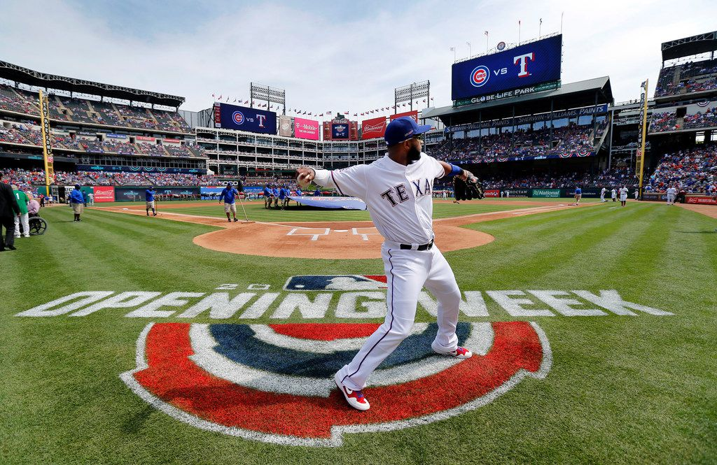 Texas Rangers shortstop Elvis Andrus warms up behind home plate before taking the field against the Chicago Cubs during Opening Day at Globe Life Park in Arlington, Thursday, March 28, 2019. Andrus is playing in his 11th consecutive season opener, tying Michael Young and Ivan Rodriguez.(Tom Fox/The Dallas Morning News)