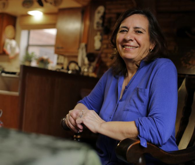 """Patrizia Cazzaniga of East Dallas enrolled in a hepatitis C drug trial in May. """"Everybody says I look much better than I did,"""" she said. """"I feel free and very happy."""""""
