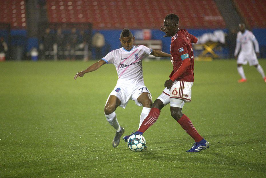 Alfusainey Jatta dribbles past Forward Madison midfielder Josiel Núñez