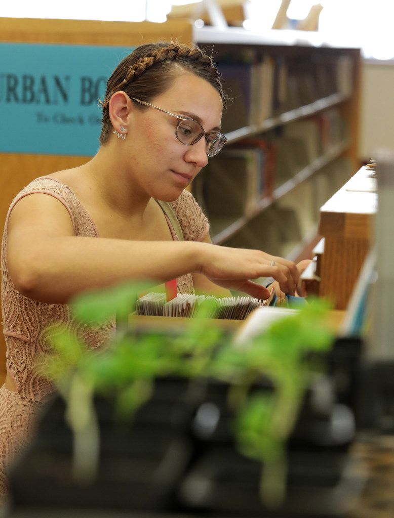 Meara Chadwick thumbs through the seed library downtown.