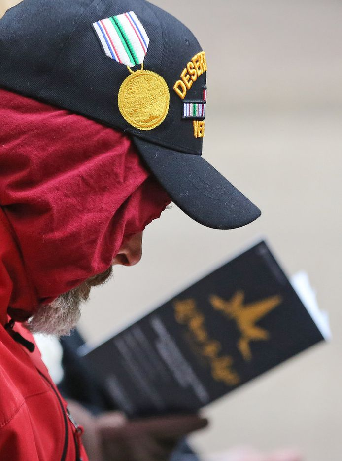 A Desert Storm veteran listens solemnly during a Pearl Harbor remembrance held at Thanks-Giving Square in downtown Dallas on Thursday, December 7, 2017. (Louis DeLuca/The Dallas Morning News)