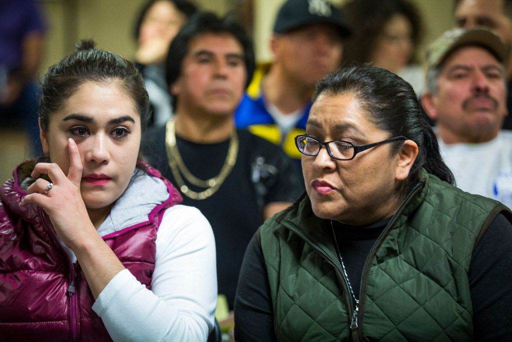 Rosa Guadalupe Torres (left) wipes away a tear as she and her mother Marta Macias talk about their concern for children they work with in an early education program before a community meeting on possible deportations at the Consulate General of Mexico on Thursday, Feb. 16, 2017, in Dallas. (Smiley N. Pool/The Dallas Morning News)