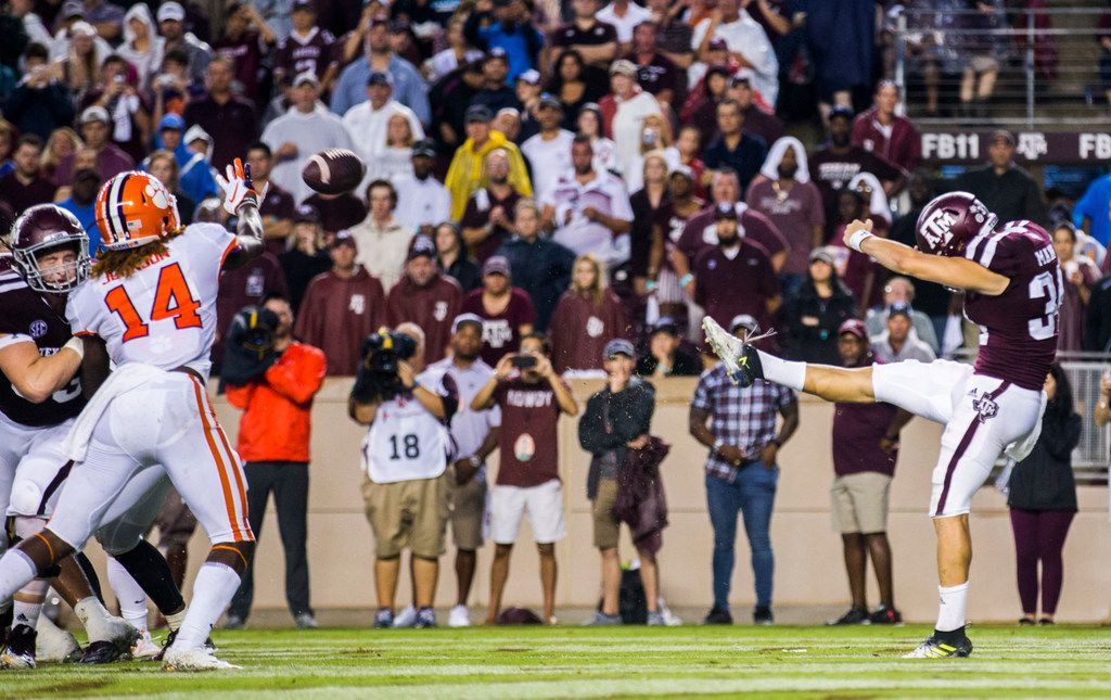 Texas A&M Aggies punter Braden Mann (34) punts the ball at the end of the second quarter during the second quarter of a college football game between the Clemson Tigers and the Texas A&M Aggies on Saturday, September 8, 2018 at Kyle Field in College Station, Texas. (Ashley Landis/The Dallas Morning News)