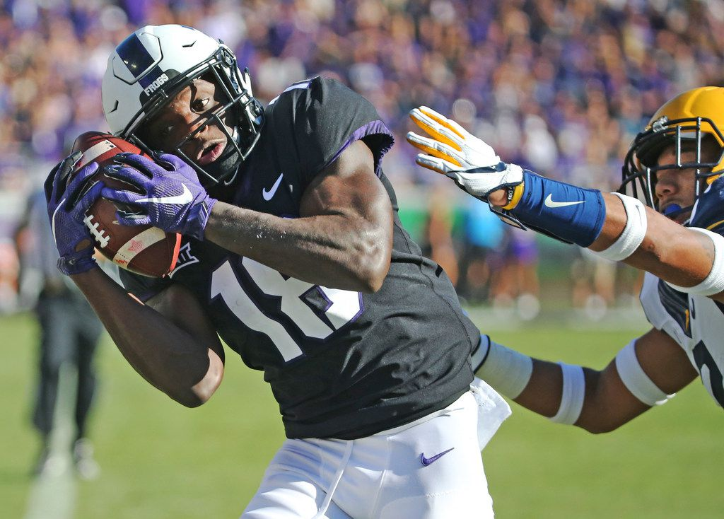 FILE - TCU wide receiver Jalen Reagor (18) catches a third quarter touchdown pass as West Virginia safety Kenny Robinson (2) defends during the West Virginia Mountaineers vs. the TCU Horned Frogs at Amon G. Carter Stadium in Fort Worth on Saturday, October 7, 2017. (Louis DeLuca/The Dallas Morning News)