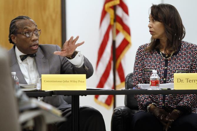 County Commissioner John Wiley Price, with Terry Smith at a meeting of the Dallas County Juvenile Board.