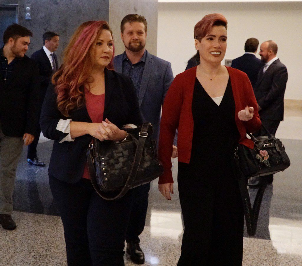 Jamie Marchi (left) and Monica Rial walk into the Tom Vandergriff Civil Courts  Building in Fort Worth Friday before a hearing in Judge John Cupp's courtroom.