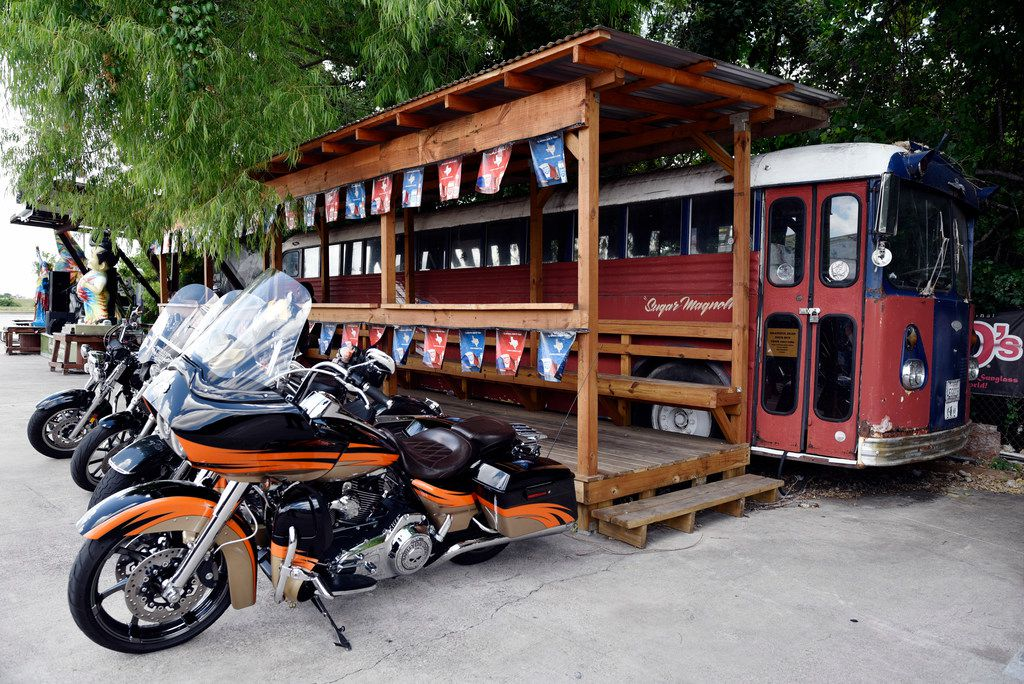 Bikes are parked near an old tour bus of the Grateful Dead.