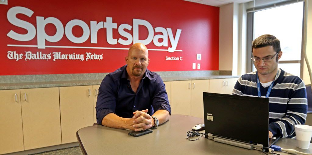 "WWE Hall of Famer ""Stone Cold"" Steve Austin, left, chats with Mark Francescutti at the Dallas Morning News office on Thursday, Nov. 5, 2015, in Dallas. (Jae S. Lee/The Dallas Morning News)"