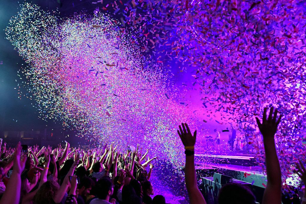 Confetti explodes into the crowd during a Tame Impala performance at the Toyota Music Factory in Irving, Wednesday Oct. 02, 2019.