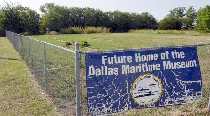 A sign marks the future site of the Dallas Maritime Museum along Riverfront Boulevard. The project is facing challenges in its bids for a submarine and presidential yacht.