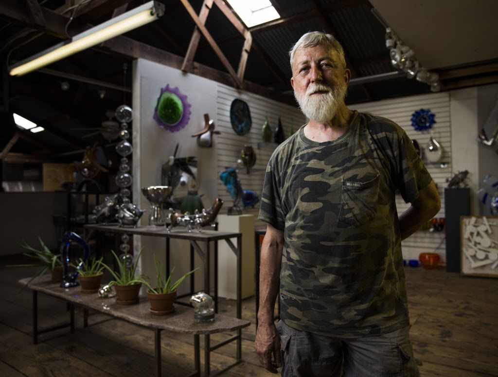 Jim Bowman, glasswork artist and owner of Bowman Glass, poses for a portrait in his studio on Tuesday, June 21, 2016 in Dallas. His studio and home are located about block south of Interstate 30 on Griffin St E. in the Cedars neighborhood, south of Interstate 30 across from downtown.