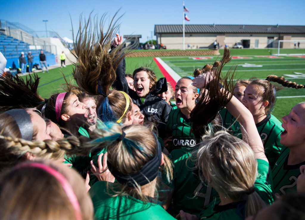 Southlake Carroll players get hyped up for their UIL conference 6A girls state semifinal soccer game between Southlake Carroll High School and Lake Travis High School on Friday, April 19, 2019 at Birkelbach Field in Georgetown, Texas. (Ashley Landis/The Dallas Morning News)