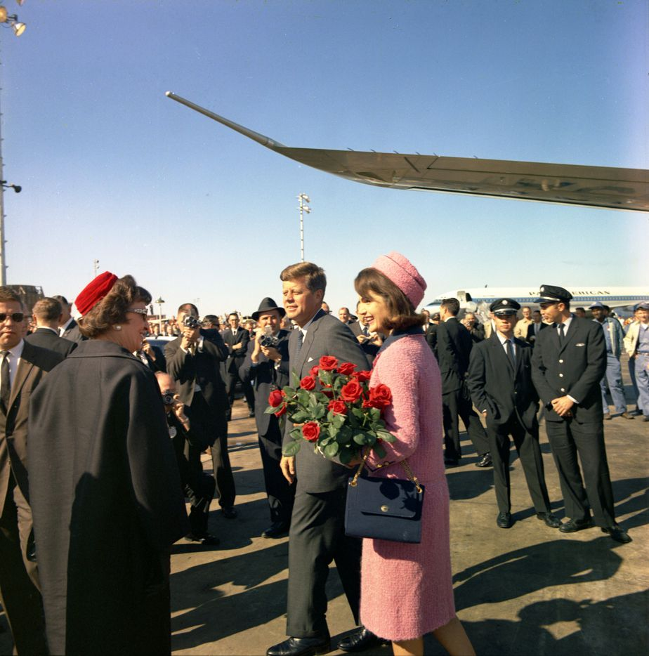 Pres. John F. Kennedy and Jacqueline Kennedy are greeted by well wishers as they arrive at Love Field in Dallas. They then departed in a motorcade for a luncheon he never made it to.