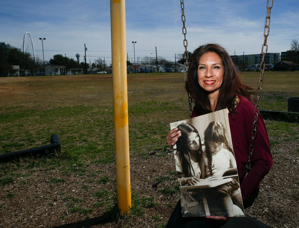 Maria Lozada Garcia, 51, La Bajada Neighborhood Community Association president, holds a photograph from when she was in preschool, being taught to read by a woman named Julia. Lozado Garcia said she cannot remember Julia's last name.